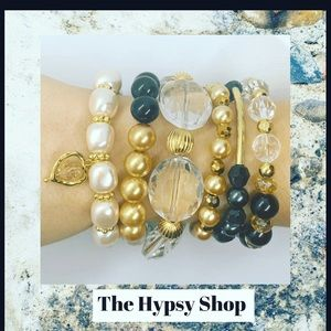 Jewelry - Gold, silver and pearls stacking bracelets.